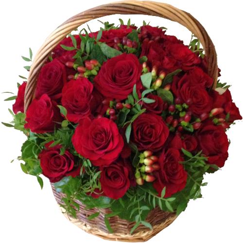 Vacker Korg med röda rosor