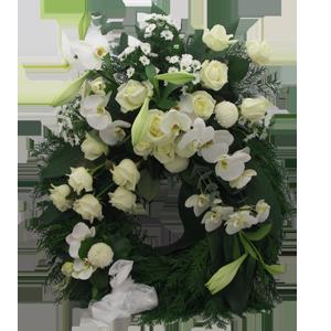 Elegant begravningskrans med vita blommor