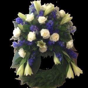 Elegant vit och blå begravningskrans