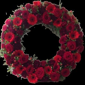 Vacker röd begravningskrans
