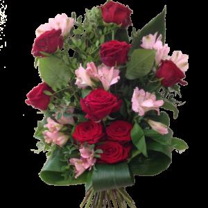 Vacker röd rosa begravningsbukett
