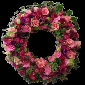 Vacker cerise-lila begravningskrans
