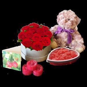 Eleganta röda rosor i hatbox